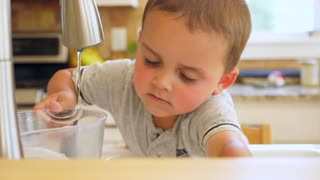 Slow Motion Shot Of A Cute Boy Playing At The Kitchen Sink