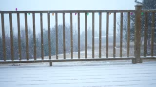Slow motion shot of a winter storm outside of the house