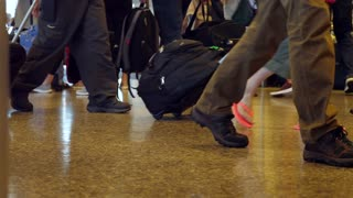 Slow Motion Shot Of People Walking Through The Airport