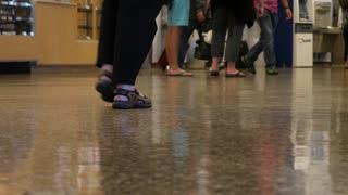 Slow Motion Shot Of Peoples Feet Walking Through An Airport