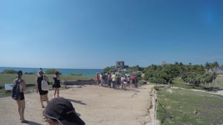 Tourists Exploring The Amazing Mayan Ruins In Beautiful Tulum Mexico