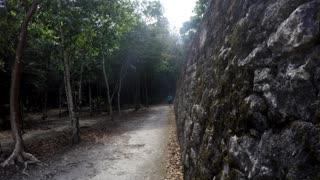 Tourists Walking Around Large Mayan Ruins In Coba Mexico