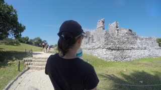 Woman Exploring Mayan Ruins In Beautiful Tulum Mexico