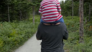Woman With Her Boy On Shoulders Hikes The Skyline Trail