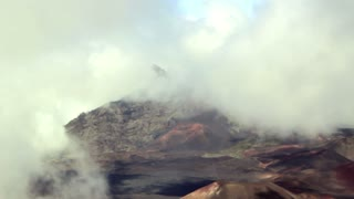 Volcano crater covered in clouds