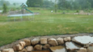 Water on the window pane of a house during storm