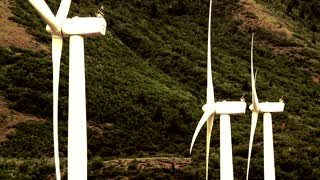 Windmills spinning in the wind creating green renewable energy