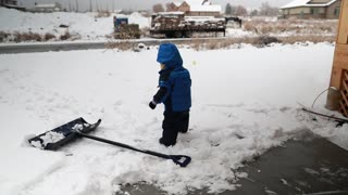 woman and her toddler walking through the snow