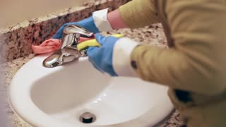 woman cleaning the bathroom counter