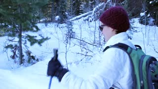 woman cross country skiing in forest