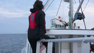 Woman Cruising On A Commercial Fishing Boat In Cape Breton
