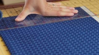 Woman cutting fabric to sew