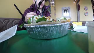 Woman eating a mexican salad in restaurant