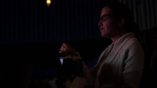 Woman Eating Popcorn Watching Movie In Theater