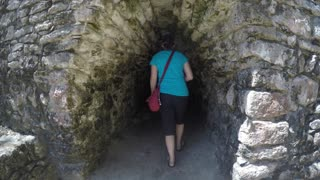 Woman in ancient Mayan tunnel at Coba