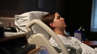 woman in labor having contractions in a hospital bed