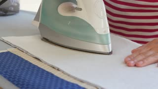 Woman ironing sewing projects