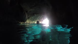 Woman Swims In Underground Cave And Water Cenote In Mexico