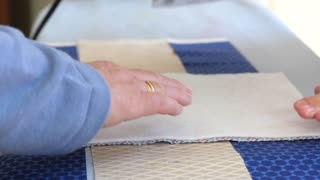 Women ironing sewing projects