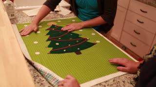 women make christmas advent calendar for craft time