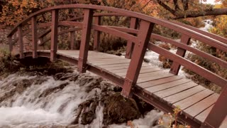Wood Footbridge Over Mountain Stream in the Fall