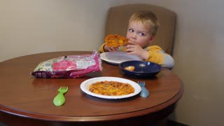 Young family eats microwave pizzas for dinner in hotel