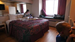 Young family in a small hotel room