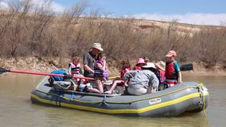young family river rafting on san juan river