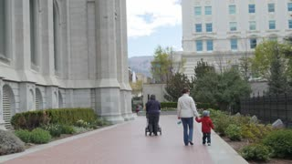 Young Family walking by Temple Square at Salt Lake City Utah