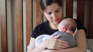 Young Mother Holding Baby After Breastfeeding