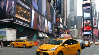 Taxi cars and yellow cabs in New York City, Times Square, Manhattan