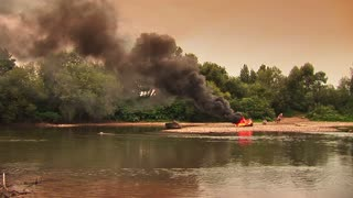A fire on the river