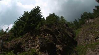 A waterfall cascades down a rocky embankment.
