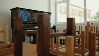 An Old piano in the empty classroom at School.