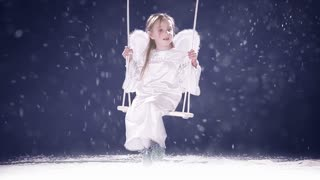 Beautiful girl dressed as an angel 2