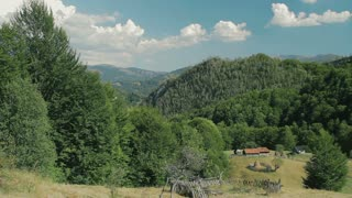 Carpathians landscape with rocks, wooded hills and meadows.