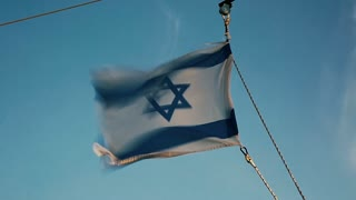 Flag of Israel on the Sea of Galilee.