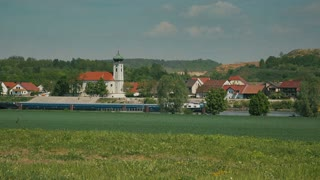 German village on Danube with church. Germany - 2014