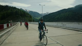Group of young people riding bikes in the mountains.