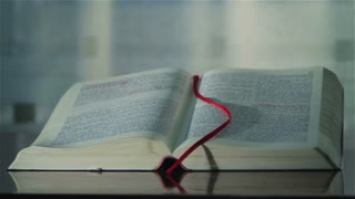 Holy Bible with bookmark. Camera rotation.