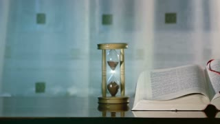 Holy Bible with hourglass 1