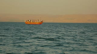 Idyllic scene with a small boat on the Sea of Galilee. Israel, cca. 2015