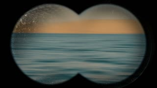 Ocean coastline - view through binoculars.
