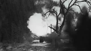 Old narrow gauge steam train in the countryside filmed in B/W.
