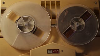 Playing a reel tape on an old tape recorder - four shots