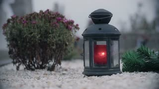 Red candle lantern on the grave 2
