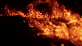 Remains of steppe burning at night. Medium shot.