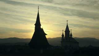 Silhouette of a wooden church in the sunset. Transylvania, Romania ̢��‰�� 2014.