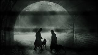 Silhouettes of the soviet soldiers with dogs. Cold war concept.