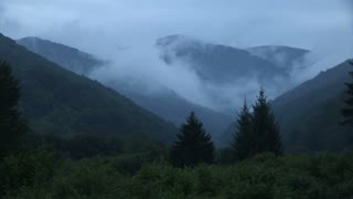 Timelaps of Carpathian mountains covered in fog.